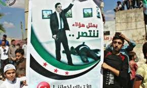 Плакат с убийцей российского посла Карлова замечен на протестной акции в Идлибе